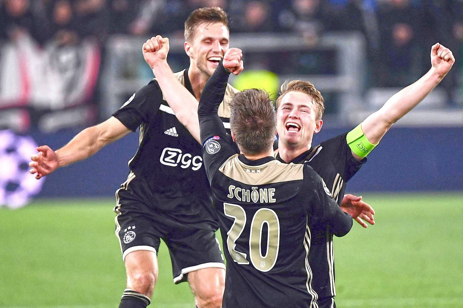 From left: Ajax defender Joel Veltman, midfielder Lasse Schone and defender Matthijs de Ligt celebrating after defeating Juventus 2-1 in the second leg of the Champions League quarter-final in Turin on Tuesday. The Dutch team won 3-2 on aggregate and