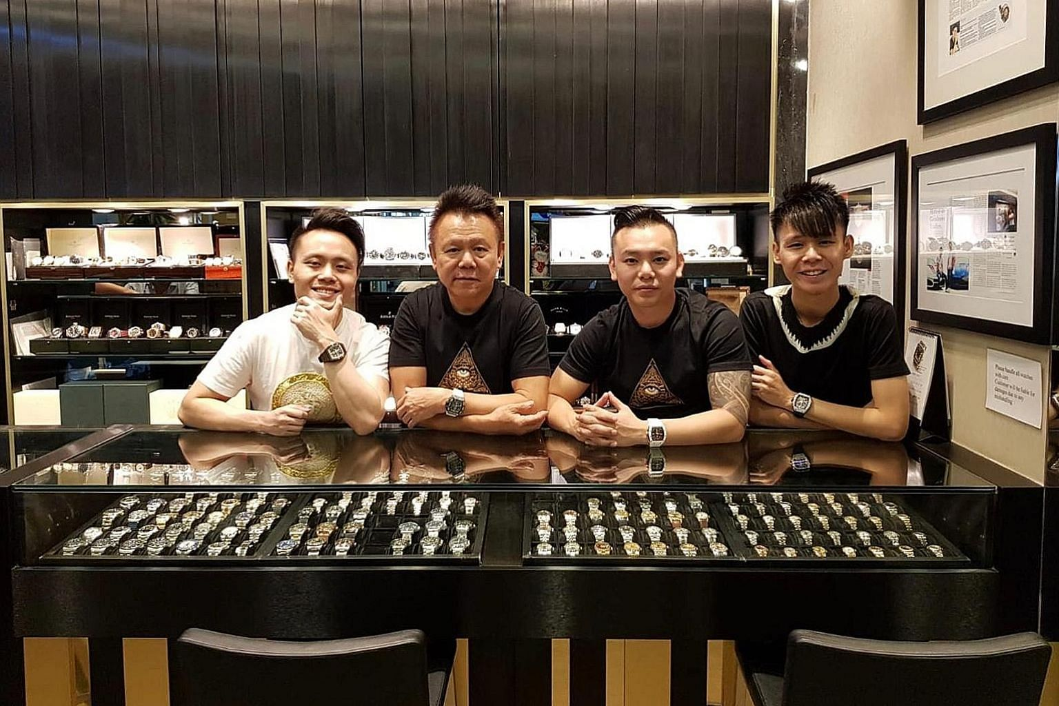 Mr Henry Lim (second from left) and his sons (from left ) Wayne, Nick and Shaun who run Chuan Watch in Golden Landmark Shopping Centre.