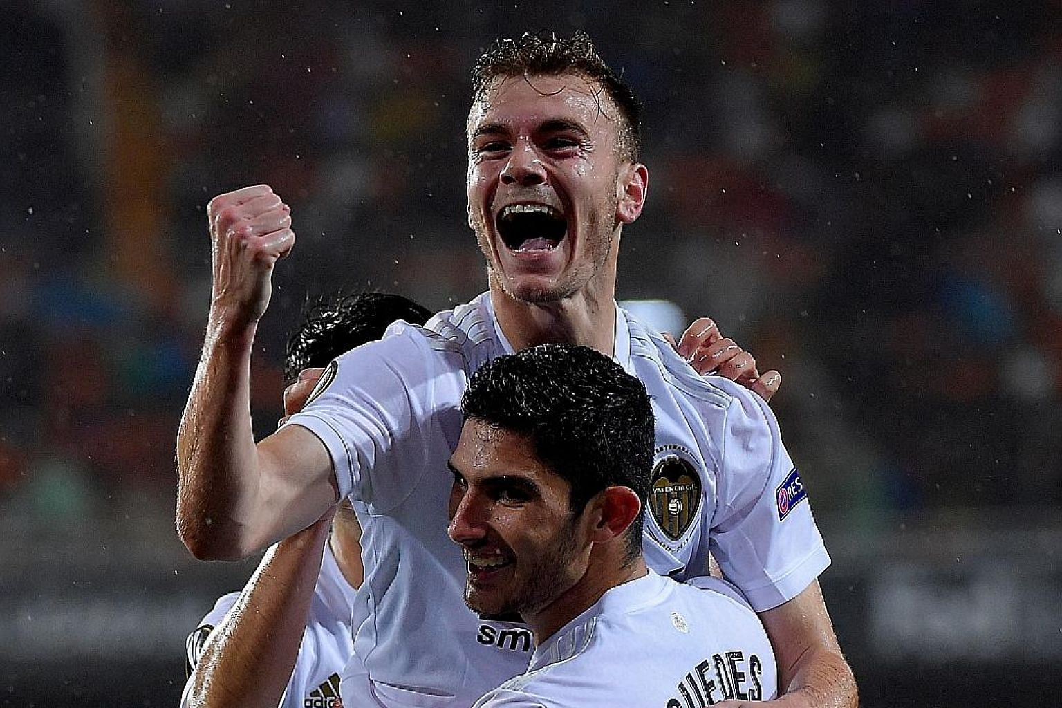 Valencia's Spanish defender Toni Lato celebrating with Portuguese midfielder Goncalo Guedes after putting them in the lead against Villarreal in the Europa League quarter-final second leg at the Mestalla.