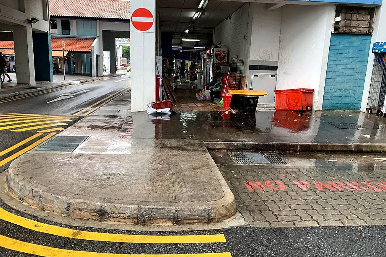 A refuse collection area near Block 966 Jurong West Street 93, where a witness saw the victim fall to the ground during a scuffle with another man. The accused has been charged with murder.
