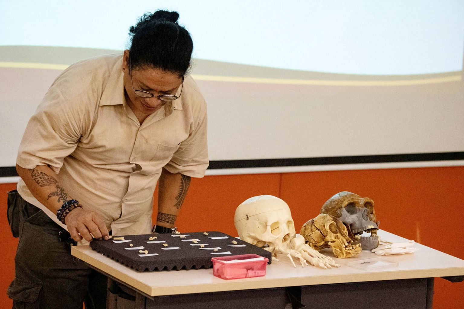 University of the Philippines archaeologist Armand Salvador Mijares with the fossils and teeth of a newly discovered human species, Homo luzonensis, at a press conference in Manila last week