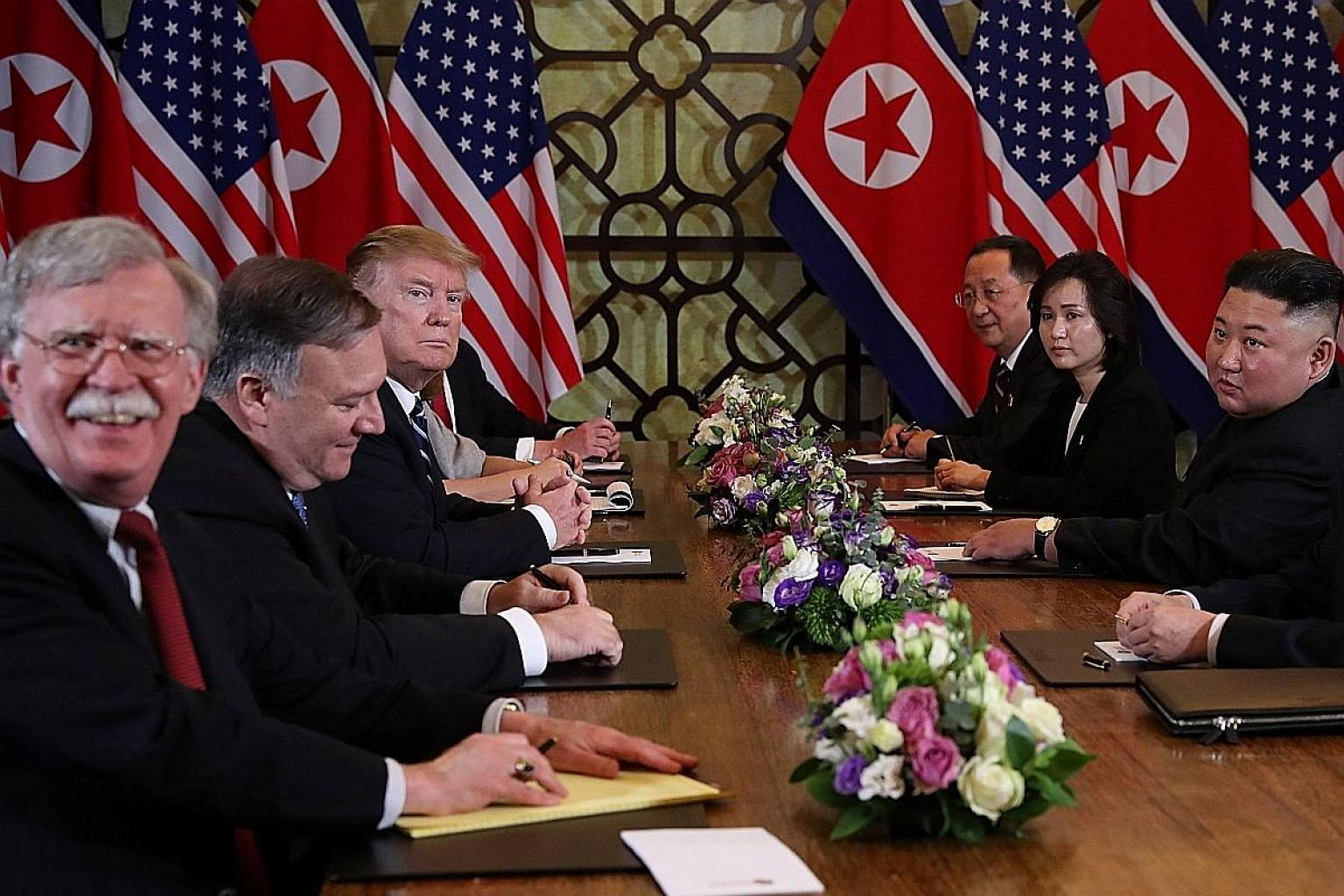 US President Donald Trump and North Korean leader Kim Jong Un with (from left) National Security Adviser John Bolton, US State Secretary Mike Pompeo and North Korean Foreign Minister Ri Yong Ho in Hanoi on Feb 28.