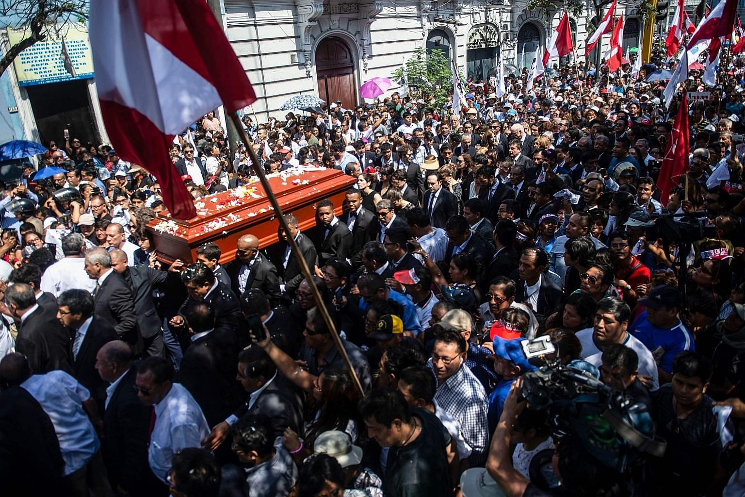 People carrying the coffin of late Peruvian ex-president Alan Garcia during his funeral procession in Lima on Friday. He died in hospital on Wednesday after shooting himself in the head at his home as the police were about to arrest him. He was suspe