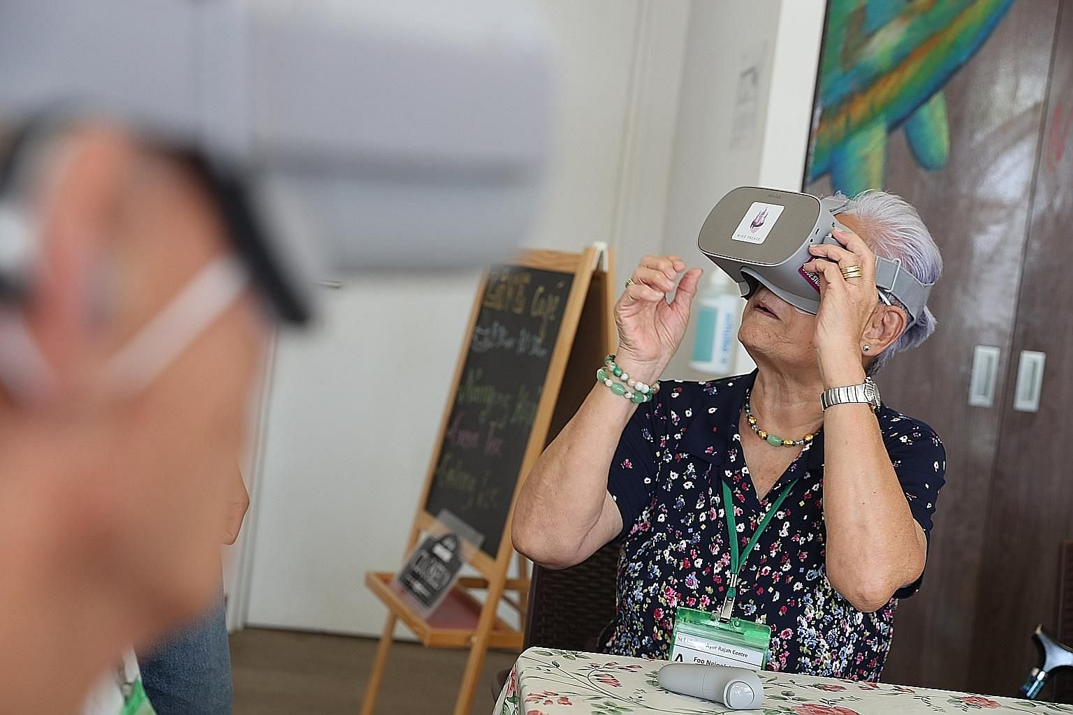 Senior citizens at St Luke's ElderCare Ayer Rajah Centre using virtual reality (VR) headsets. VR aids are said to improve the memory recall and attention span of dementia patients. They can also be used to help elderly residents with mobility constra