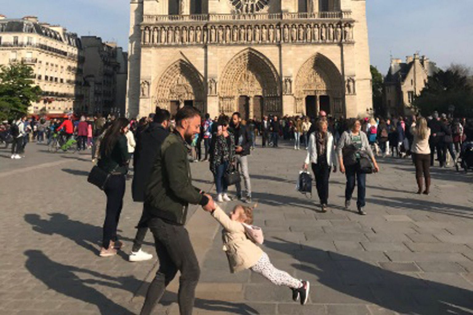 US tourist Brooke Windsor photographed this man and his daughter in front of Notre-Dame cathedral in Paris on Monday, an hour before the fire broke out. The photo reached the family, after her tweet went viral.