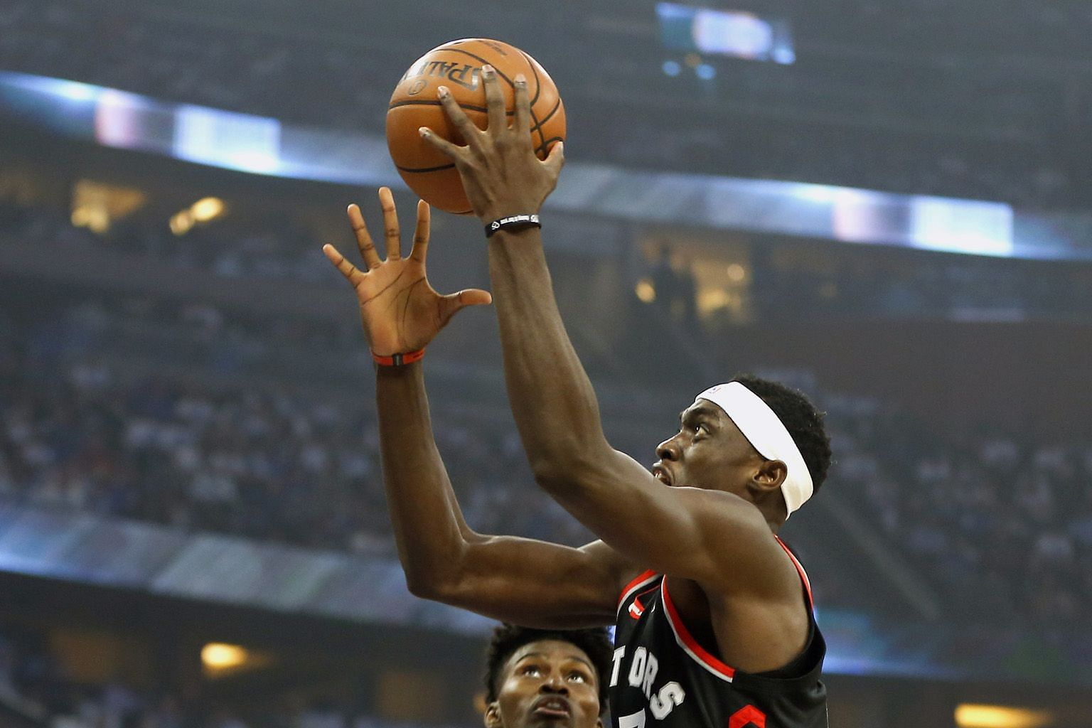 Toronto Raptors forward Pascal Siakam driving past his Orlando Magic counterpart Jonathan Isaac to the basket during Game 3 of the first round of the NBA play-offs at Amway Centre, Orlando, on Friday. The Raptors won 98-93 to lead the series 2-1. PHO