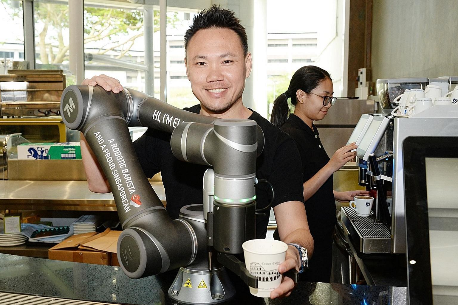Local coffee chain Crown Coffee launched the first robot barista in Singapore in 2017. The robot uses facial recognition to recognise repeat customers and tracks their consumption patterns, but the chain's founder Keith Tan (left) says that the firm