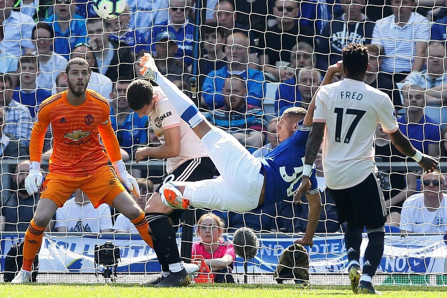 Brazilian Richarlison firing Everton ahead in the 13th minute with an acrobatic high volley at Goodison Park yesterday to start the ball rolling for the Toffees, who recorded their biggest win over United since October 1984.