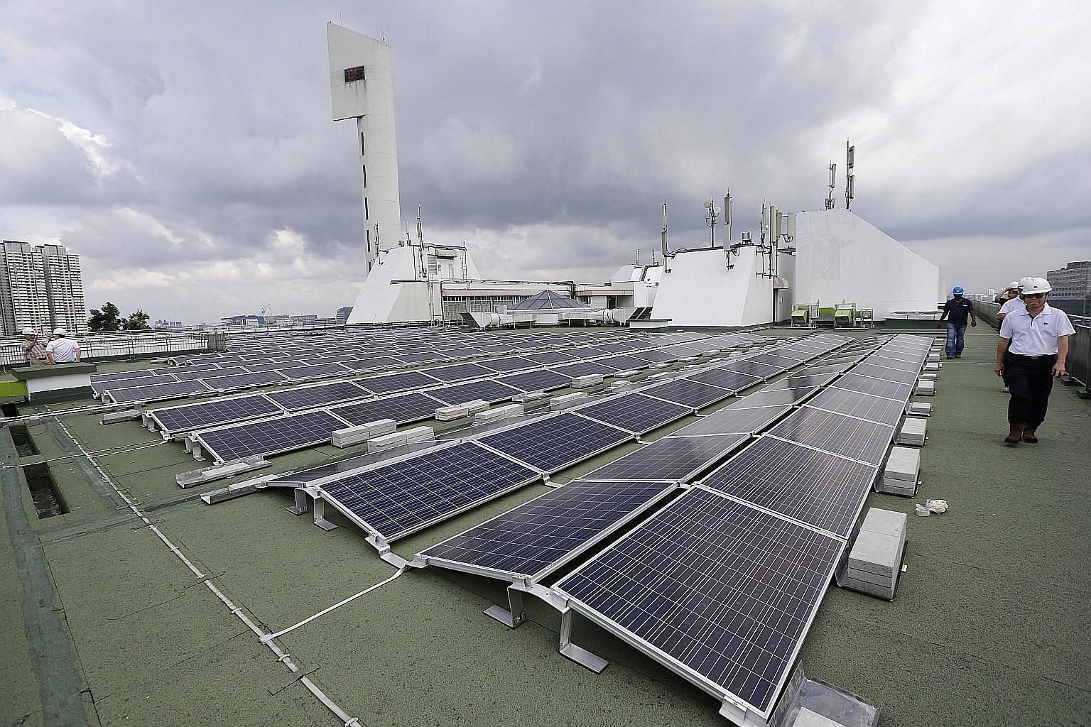 Solar panels on the rooftop of Jurong Town Hall. Under the memorandum of understanding, the Energy Market Authority and the United States' Federal Energy Regulatory Commission will share regulatory practices and explore how best to keep energy system
