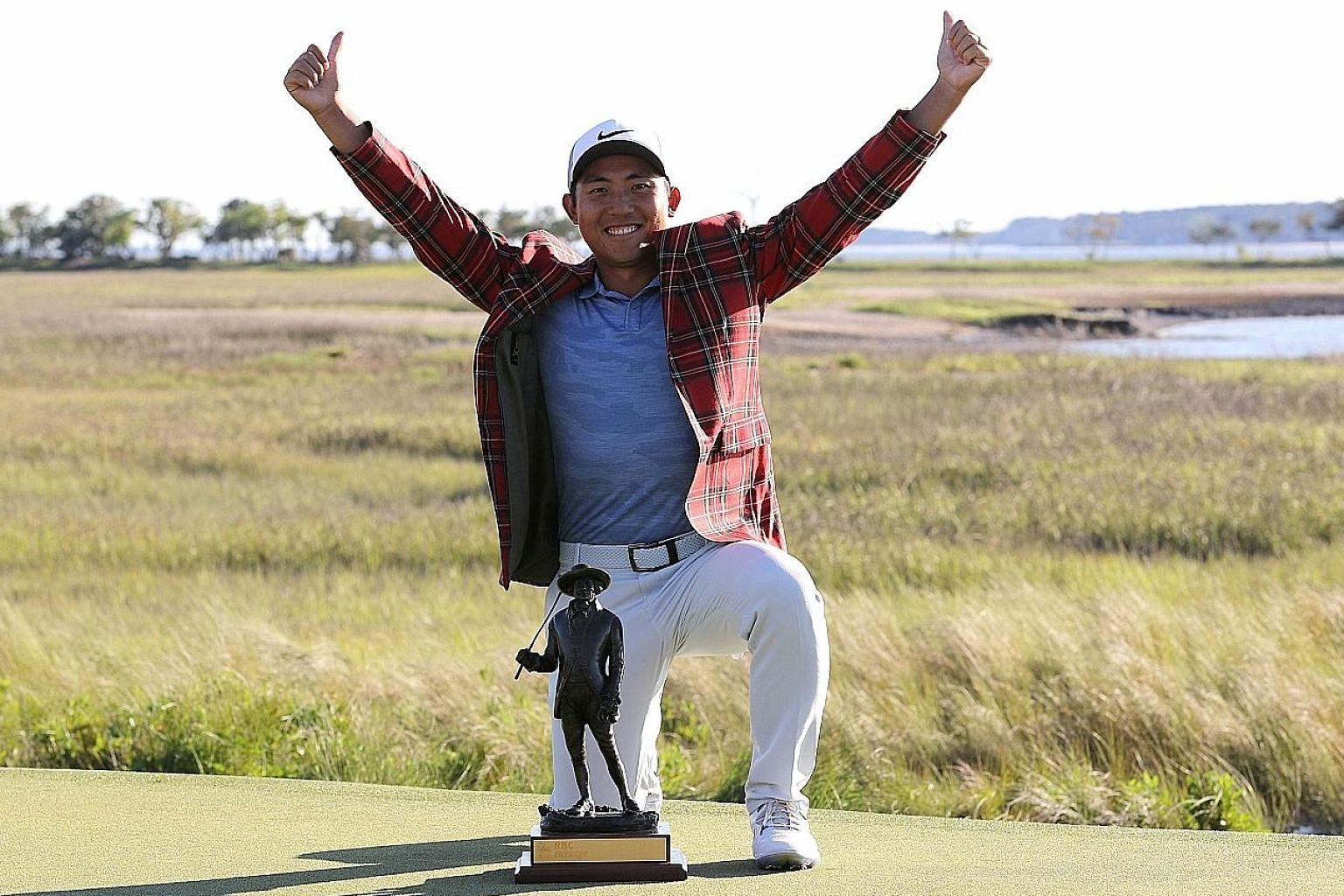 A joyous Pan Cheng-tsung with the RBC Heritage trophy after winning the event by a shot on Sunday at Harbour Town Golf Links on Hilton Head Island, South Carolina. PHOTO: AGENCE FRANCE-PRESSE