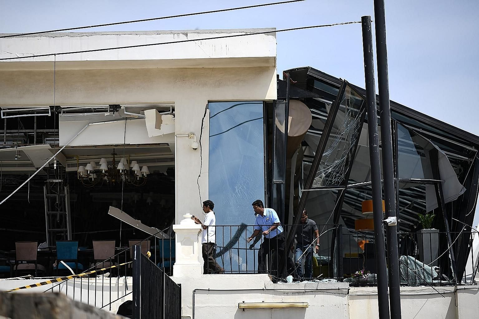 A damaged section of a restaurant at The Kingsbury Hotel in Colombo yesterday. The Sri Lankan government is facing criticism after acknowledging that it did not act on earlier warnings of possible suicide attacks.