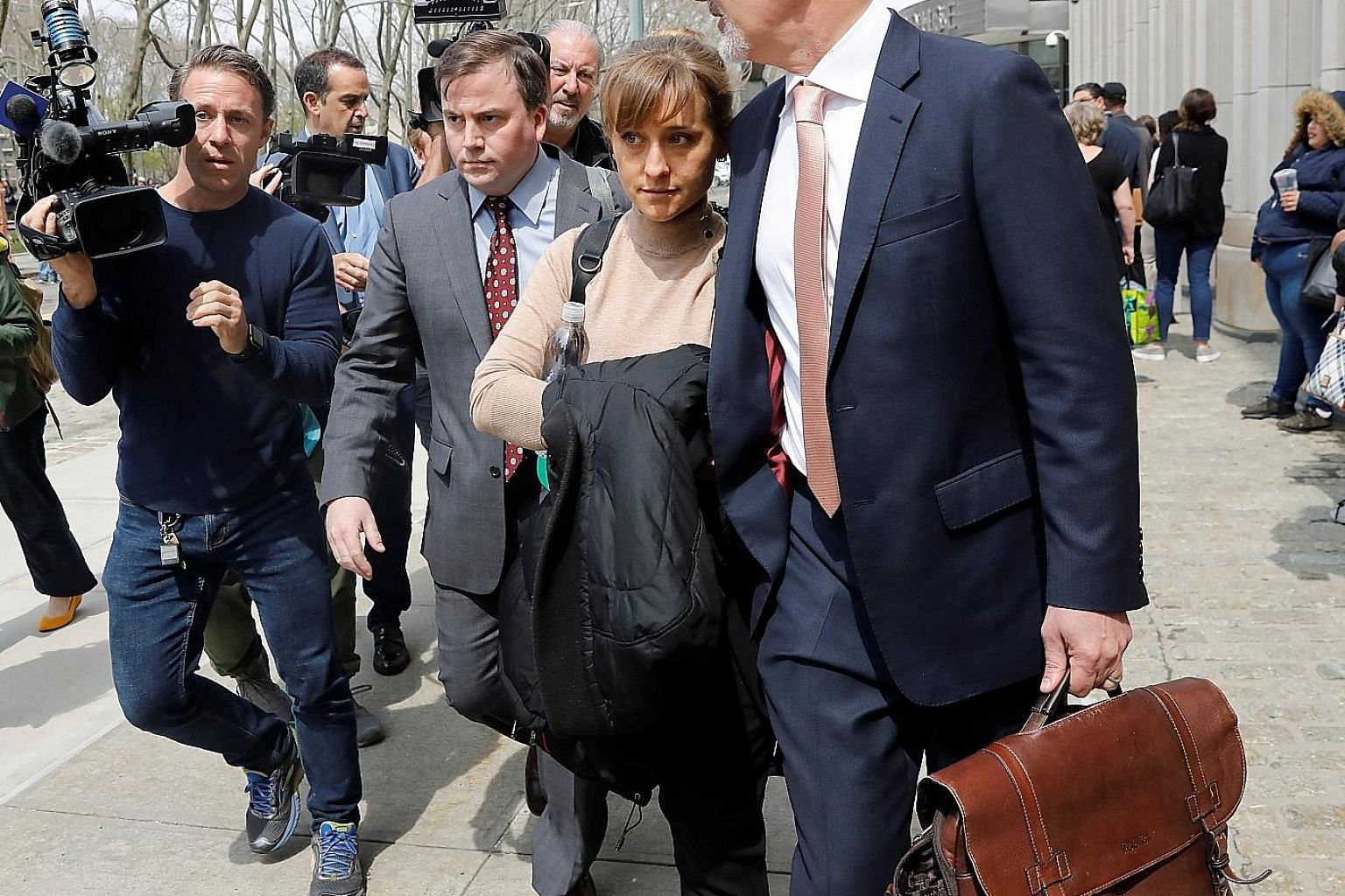 Actress Allison Mack leaving the Brooklyn Federal Courthouse after facing charges regarding sex trafficking and racketeering related to the NXIVM cult case in New York.