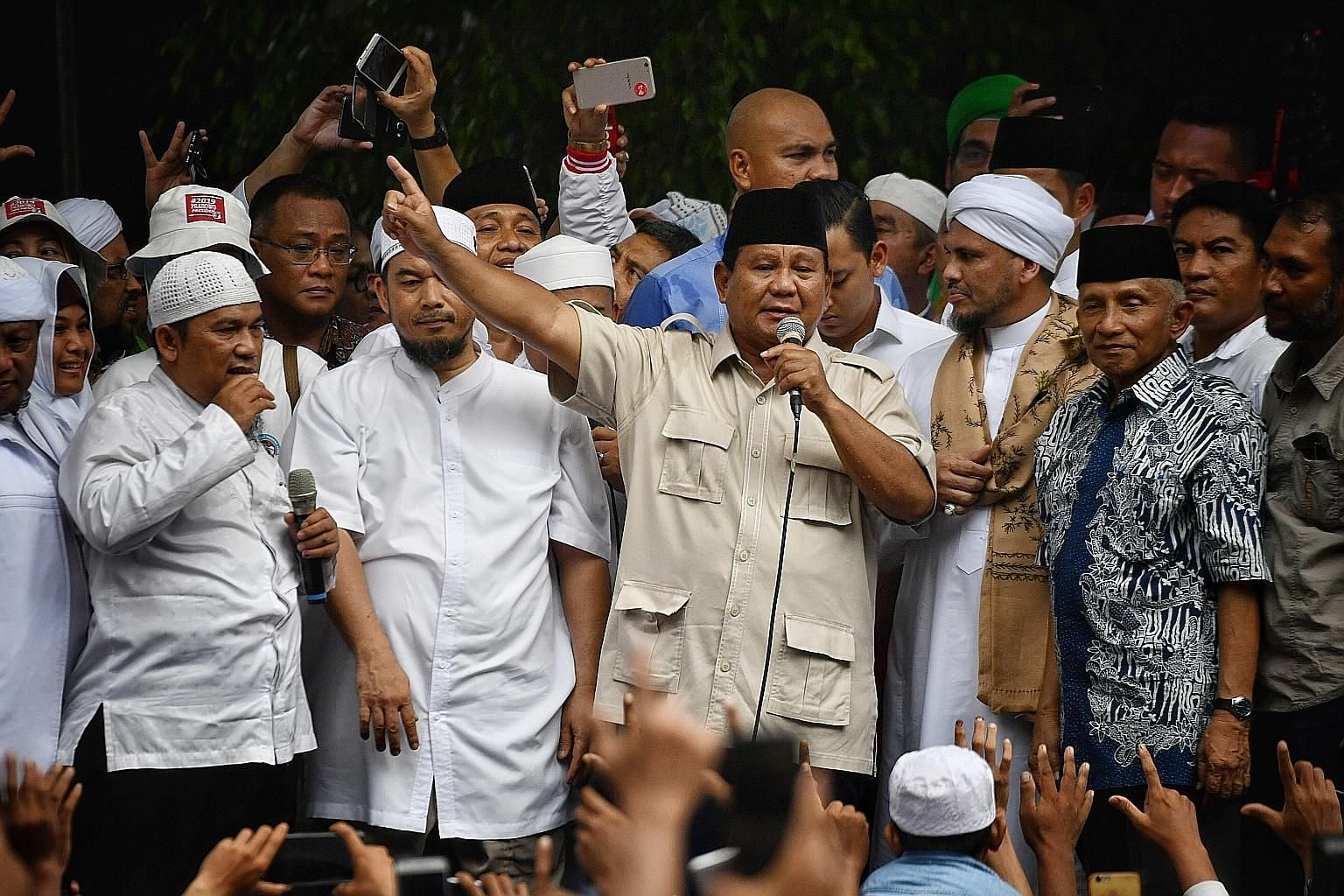 Presidential hopeful Prabowo Subianto, speaking to supporters outside his Jakarta residence last Friday, is dismissing unofficial quick counts and claiming he has won the election before the election commission has announced official results.