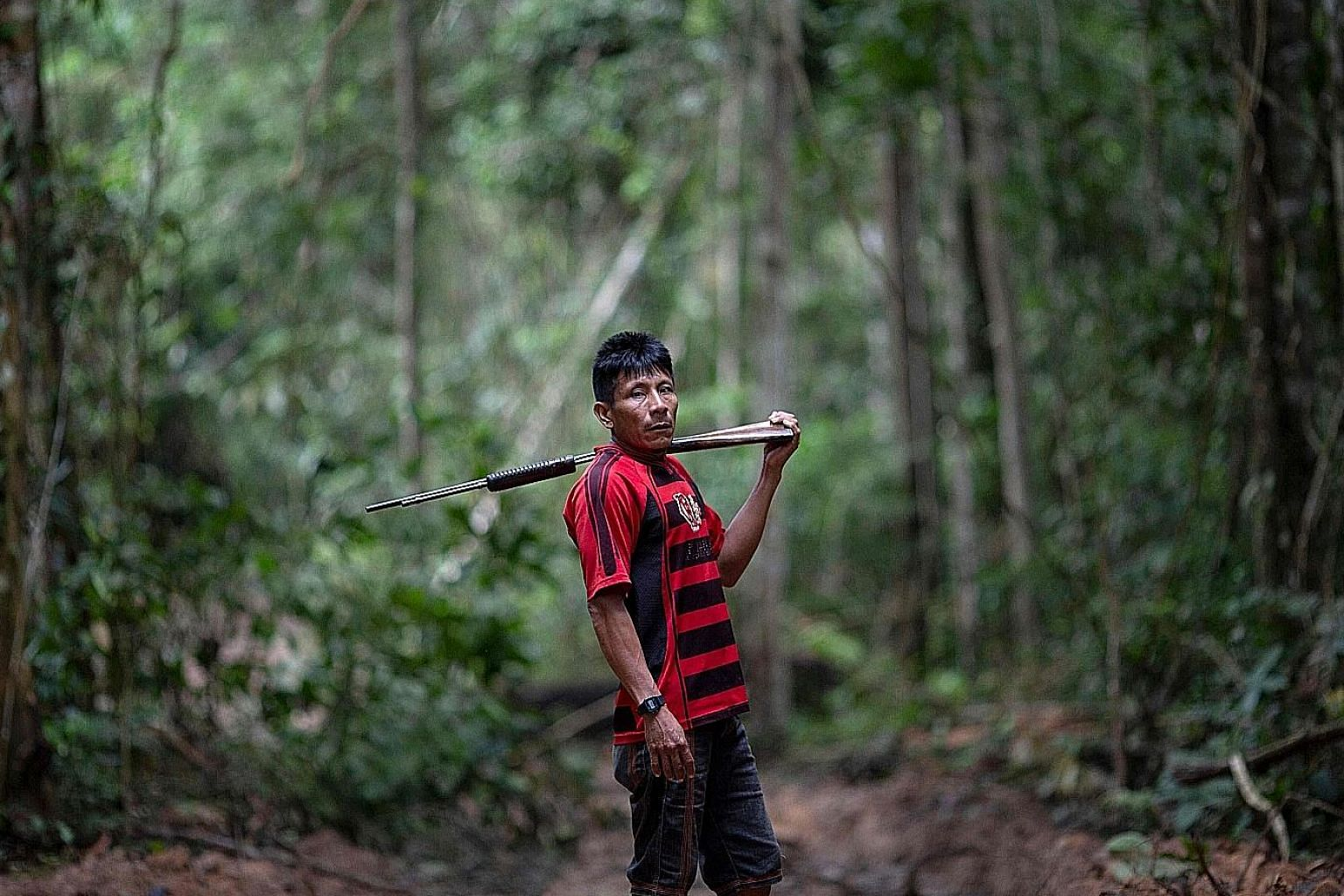 Arara indigenous chief Tatji Arara patrolling the Arara indigenous land in Para state, Brazil, last month. He says illegal logging on these lands - an area equivalent to 264,000 football fields - has intensified since President Jair Bolsonaro came to