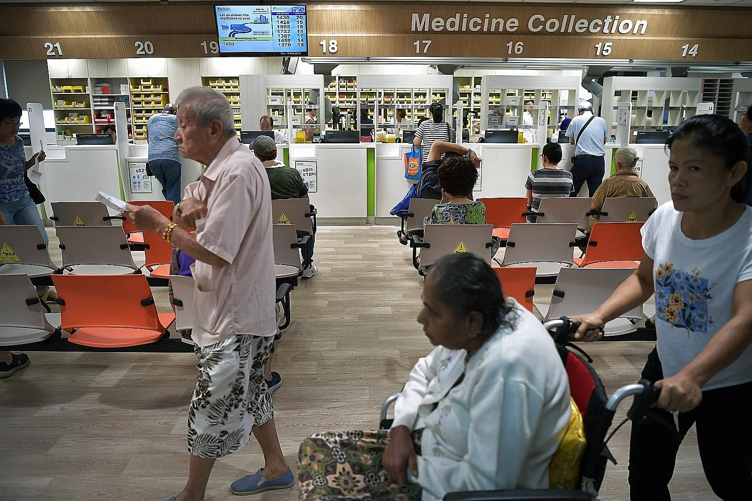 Patients at the pharmacy of Ang Mo Kio Polyclinic. Singapore's polyclinics are a marvel of efficiency, says the writer, and have been designed to process as many patients as quickly as possible.