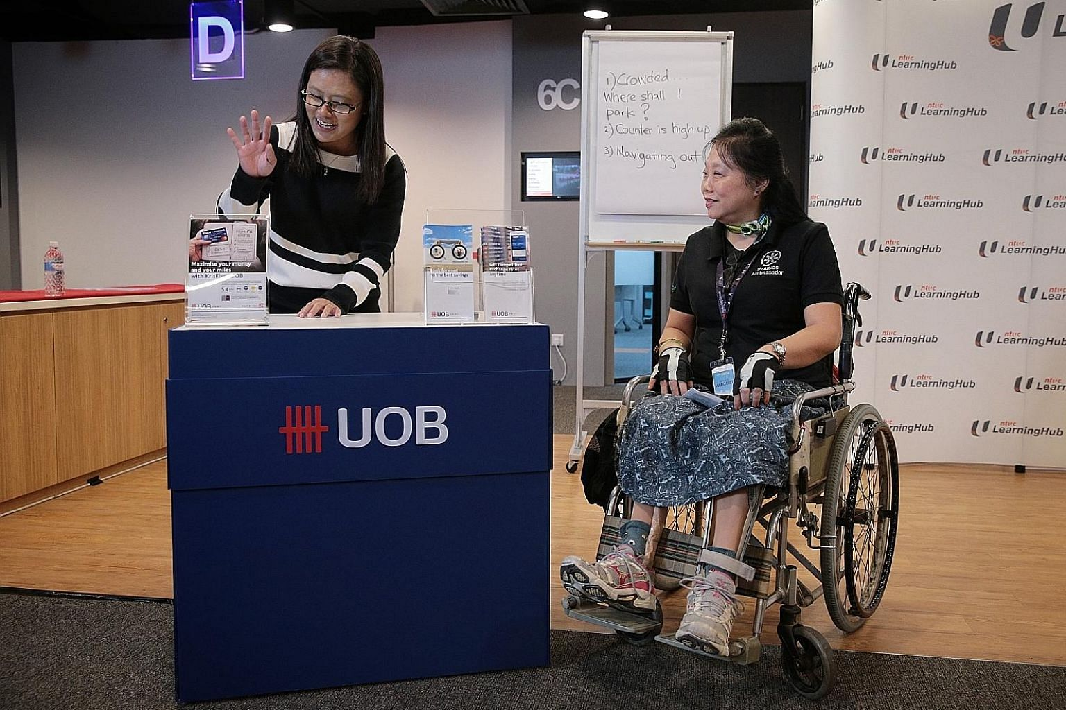 Deputy branch manager Heng Siew Pheng of UOB's Tampines branch and Disabled People's Association ambassador Margaret See at the Service Inclusiveness Programme's media launch event.