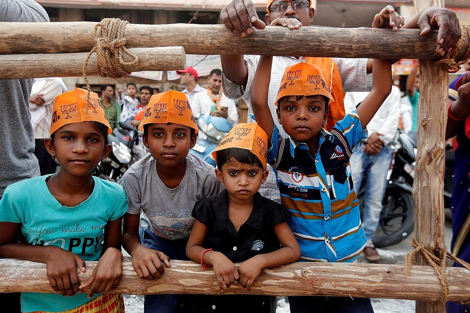 Children showing support for Indian Prime Minister Narendra Modi's Bharatiya Janata Party at a roadshow in Varanasi, India, yesterday.