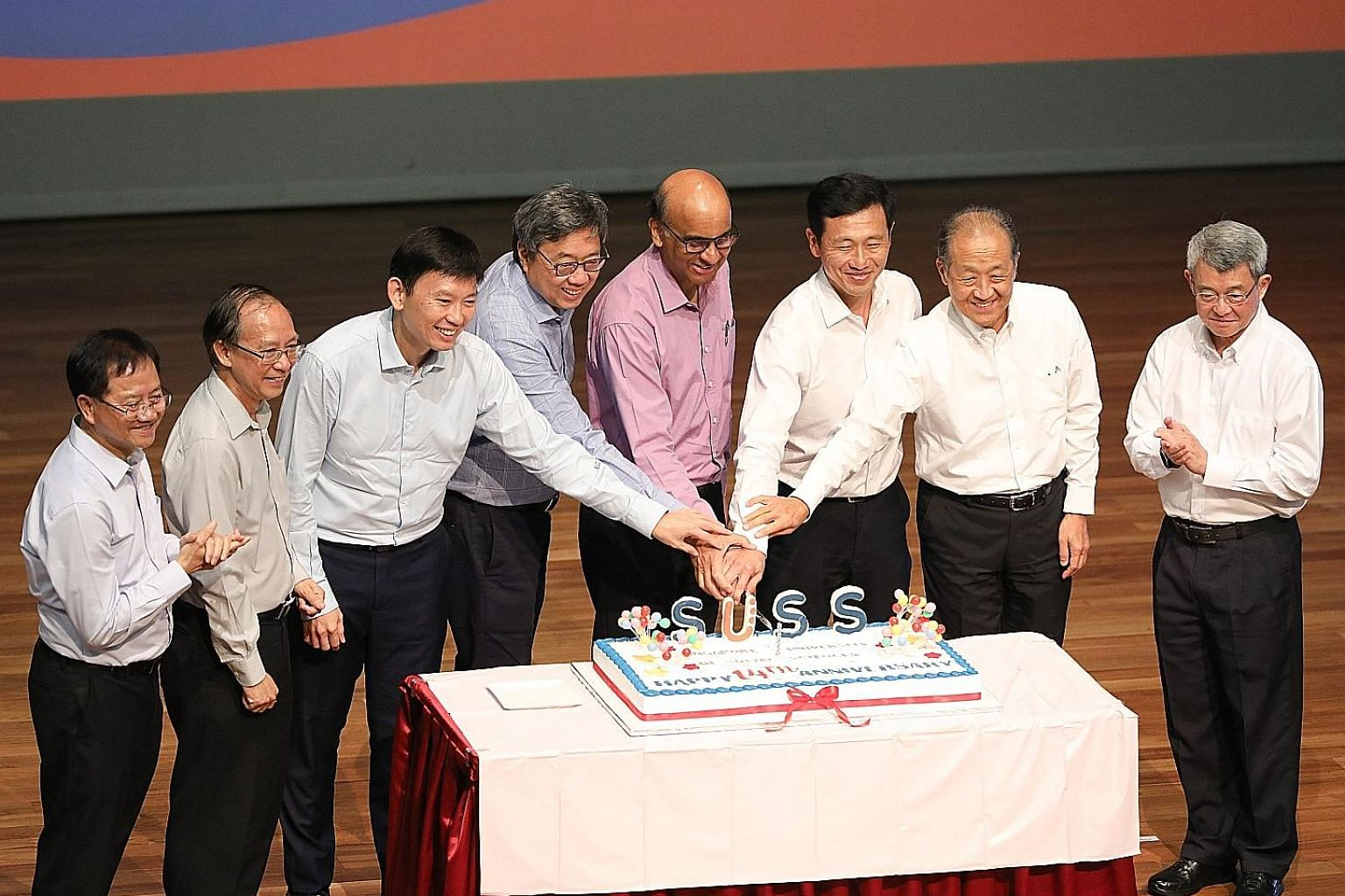 Attending the Singapore University of Social Sciences' 14th anniversary celebration yesterday were (from left): Institute for Adult Learning executive director Lee Wing On; SUSS president Cheong Hee Kiat; Senior Minister of State for Education Chee H