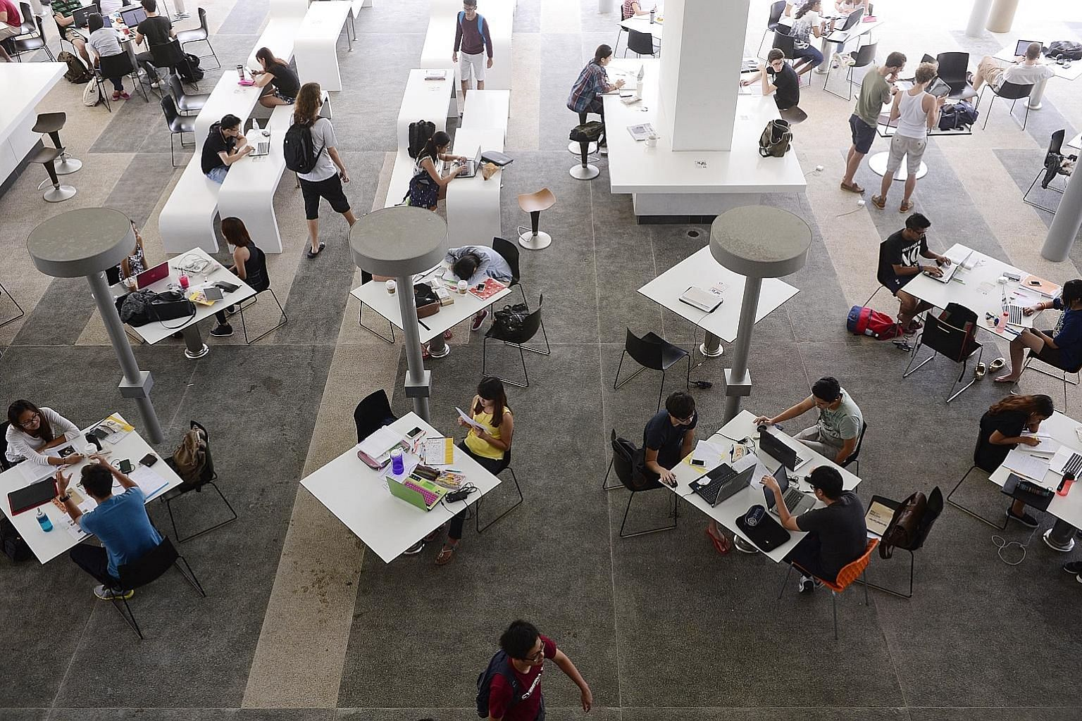A file photo of students in a common area in University Town student residence at NUS. The outcry over the recent sexual misconduct case at NUS has drawn attention to how such offences are handled and the case will also impact other universities and