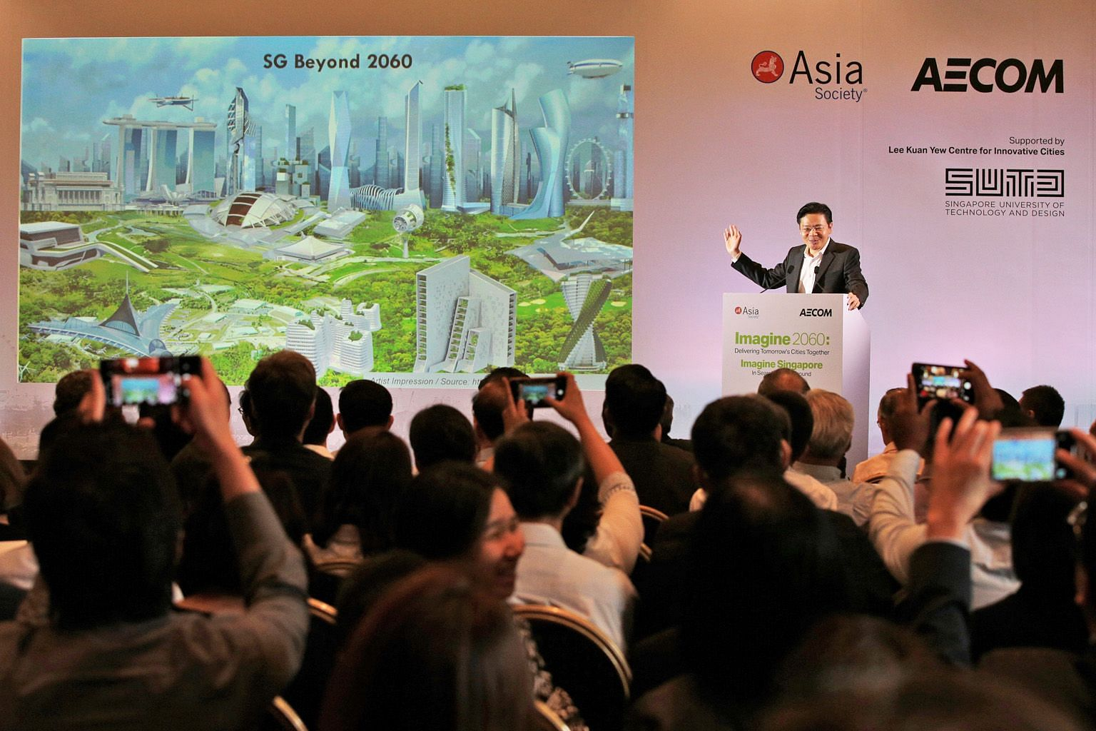 National Development Minister Lawrence Wong showing an artist's impression of Singapore beyond 2060 at the Imagine 2060 forum at the Asian Civilisations Museum yesterday.