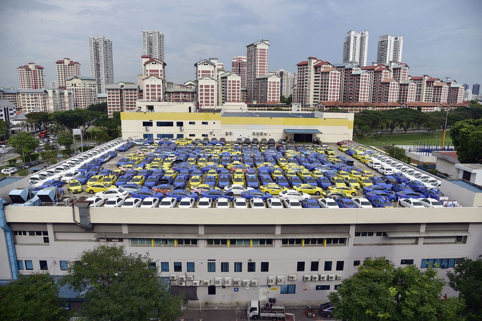 Taxis parked on the rooftop of the CityCab Building in Sin Ming. Since private-hire operators arrived in 2013, the taxi industry has been shrinking. There are now around 20,000 cabs on the road, down from around 28,000 at its peak. ST PHOTO: DESMOND