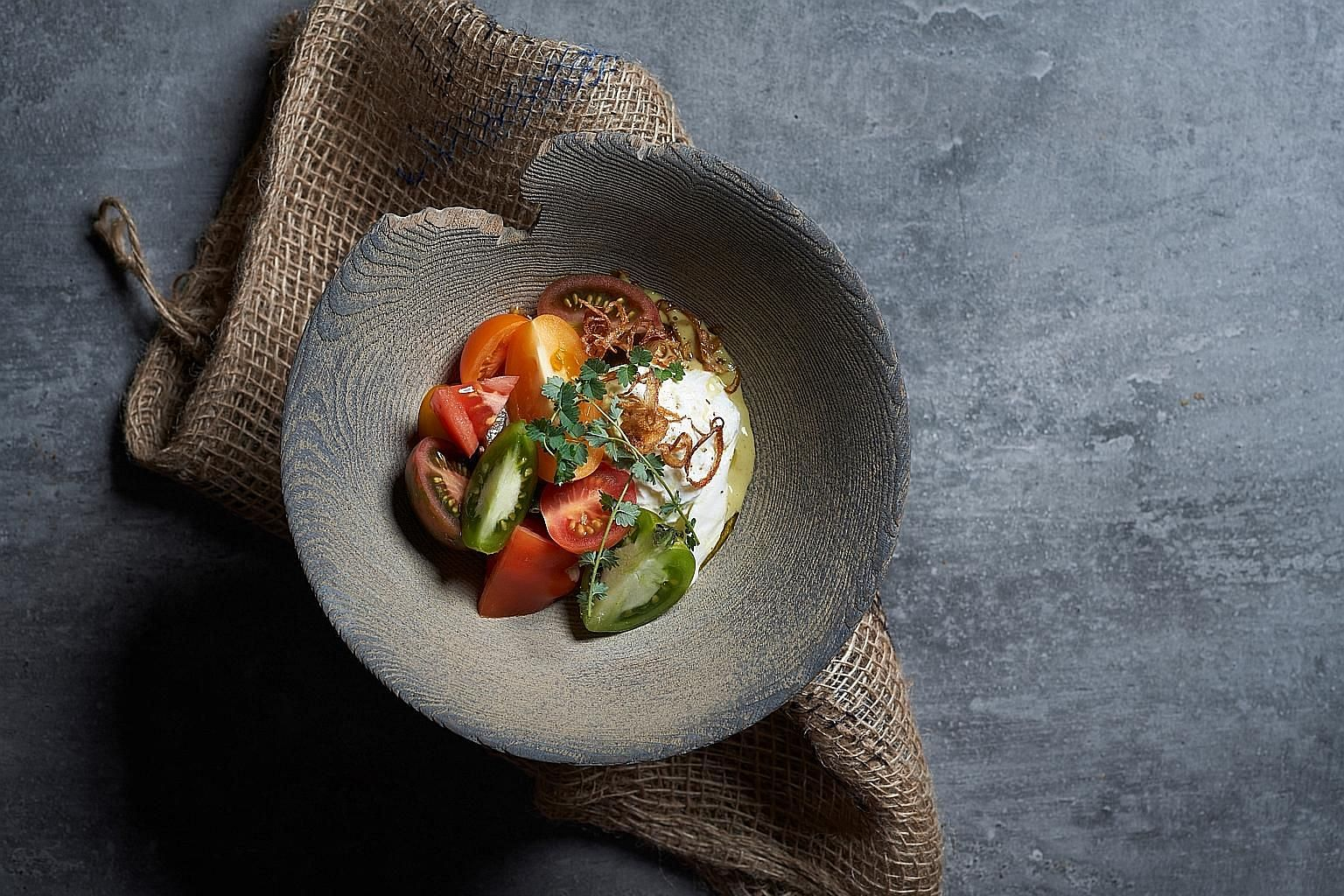 Burrata is spiced up with fermented green chilli.