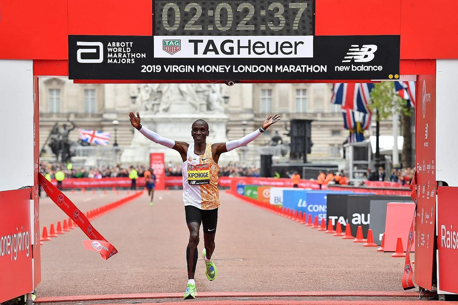 Kenya's Eliud Kipchoge, 34, crossing the finish line in 2hr 2min 37sec to win his fourth London Marathon yesterday.