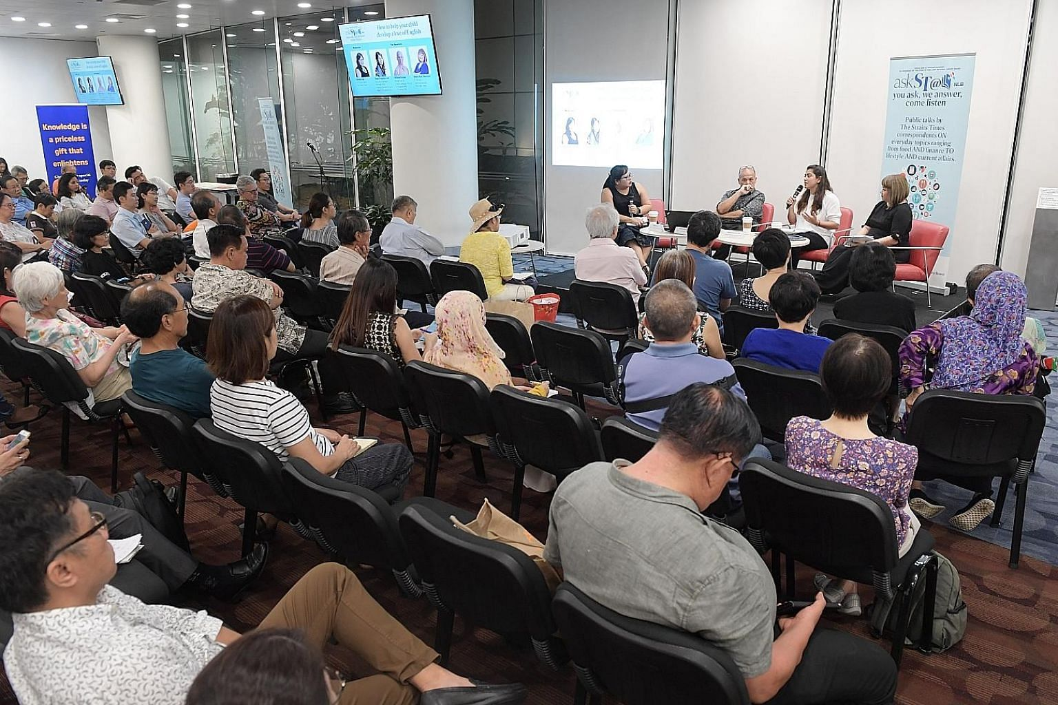 Mrs Anne Kingsley-Lee, a curriculum specialist at Rainbow Centre, recounting her experience with her son to a crowd of 230 people at the askST@NLB session at the Central Public Library on Friday. With her on the panel were moderator and Straits Times