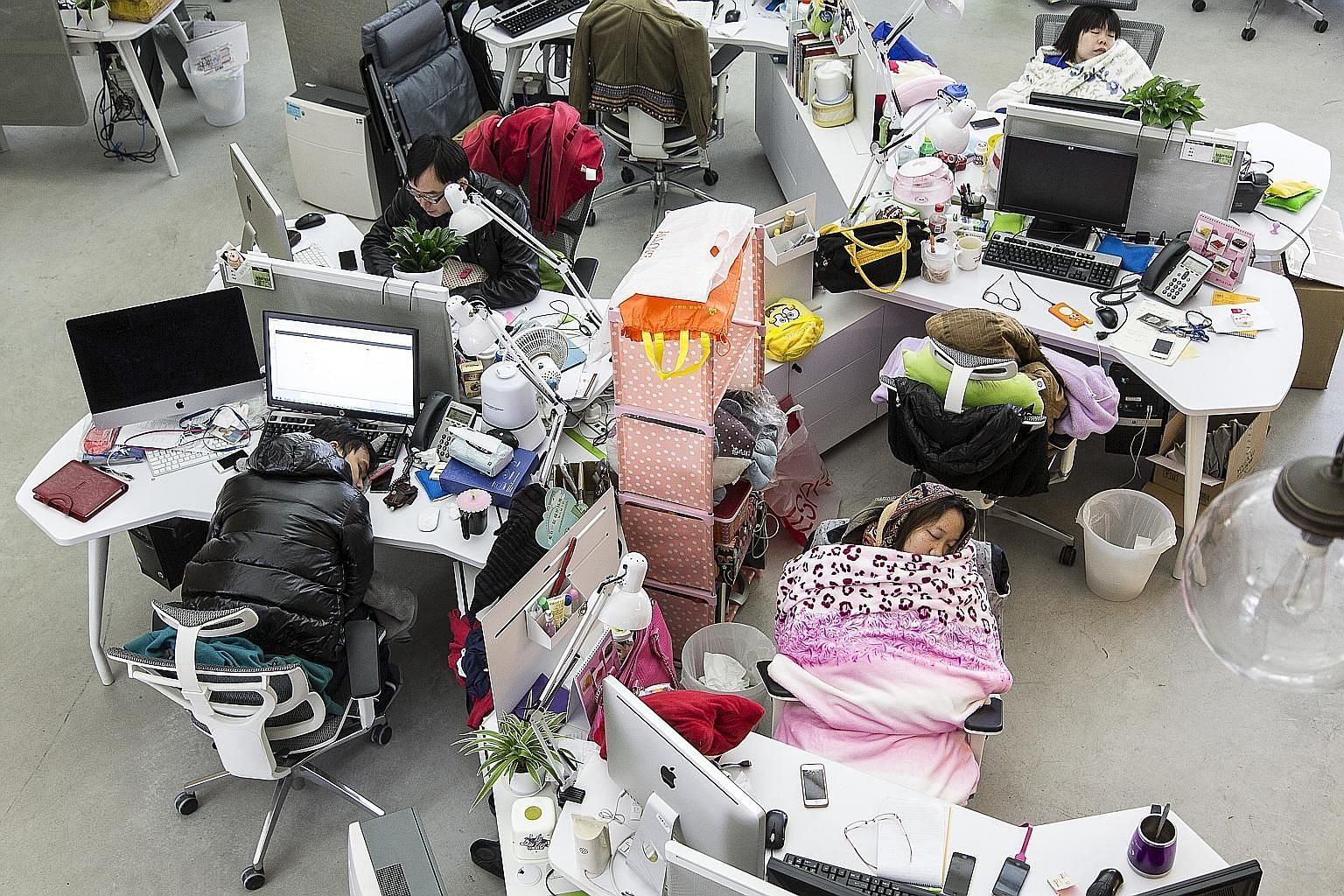Employees taking naps during lunch hour at Tencent in Guangzhou in 2013. Rank-and-file tech workers in China, discouraged by a weakened job market and downbeat about their odds of joining the digital aristocracy, are organising online against what is