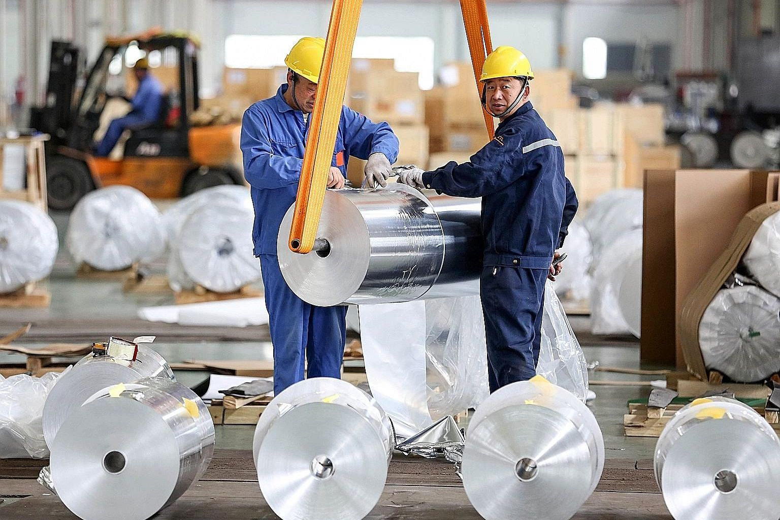 Workers packing aluminium sheets at a factory in Huaibei, in China's Anhui province. The country's manufacturing Purchasing Managers' Index stood at 50.1 last month, down from 50.5 in March.