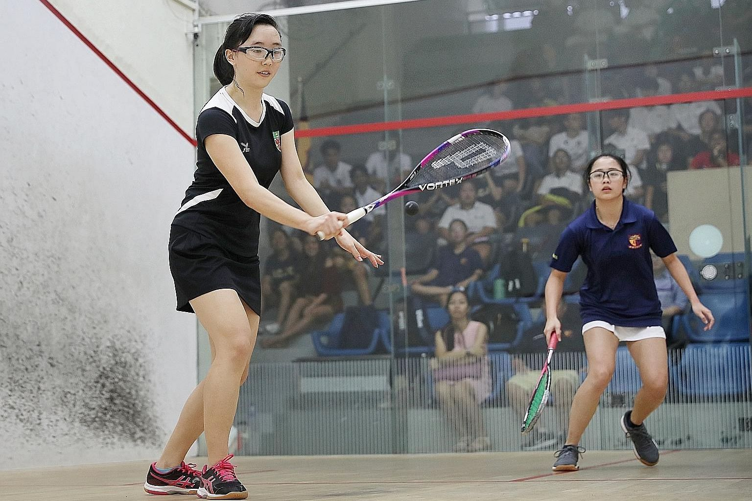 Captain Nicole Tong (far left) beating ACJC's Jewel Tan 11-0, 11-0, 11-3 to give RI a 2-0 lead in the Schools National A Division girls' squash final at Kallang Squash Centre yesterday. RI won 5-0.