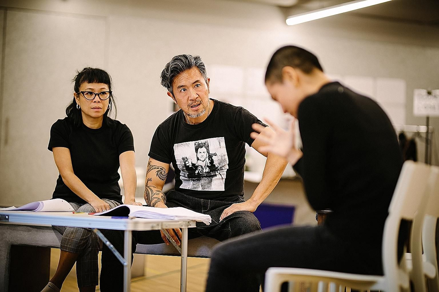 Actor Adrian Pang (centre) during rehearsals with Pam Oei for This Is What Happens To Pretty Girls. The play is fictional but playwright Ken Kwek interviewed more than 100 women, as well as some men accused of inappropriate sexual behaviour, before p
