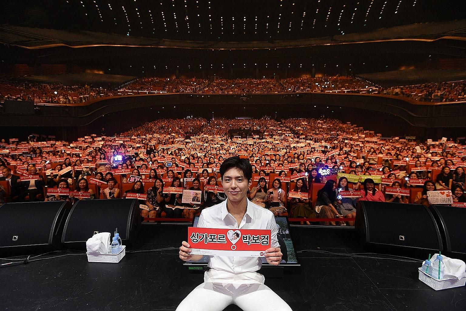 Several South Korean artists such as (clockwise from top left) actors Park Bo-gum and Lee Seung-gi, who is hugging a fan from behind, and girl group Mamamoo held fan meetings in Singapore.