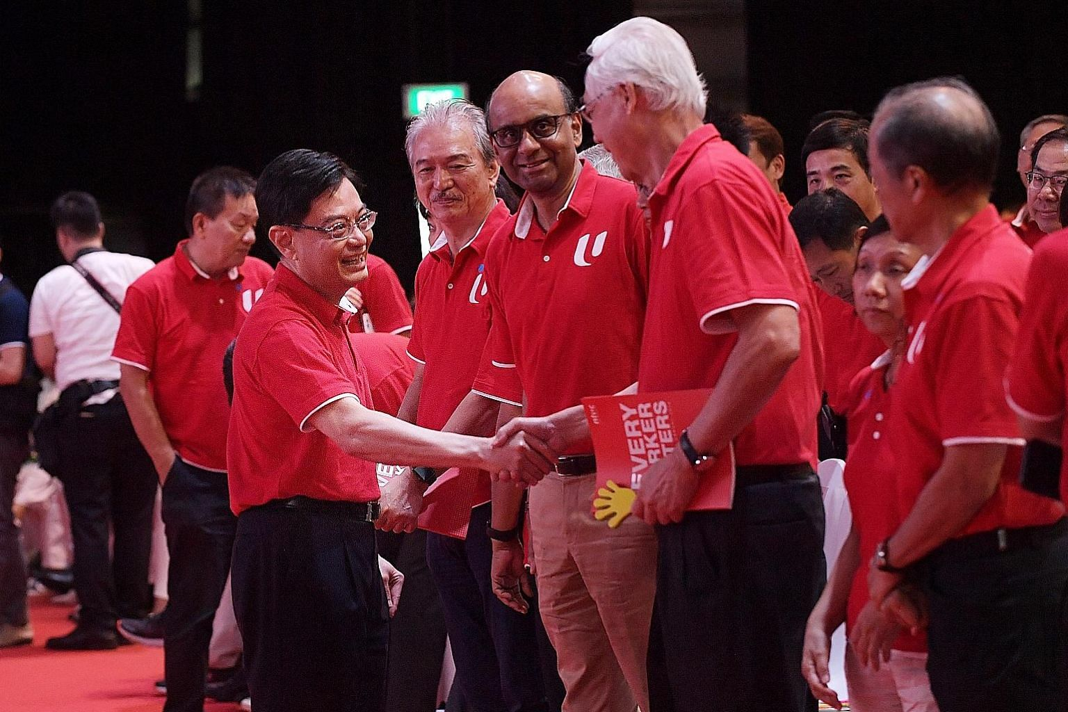Deputy Prime Minister Heng Swee Keat greeting Emeritus Senior Minister Goh Chok Tong at Downtown East yesterday while Senior Minister Tharman Shanmugaratnam looked on. ST PHOTO: ALPHONSUS CHERN