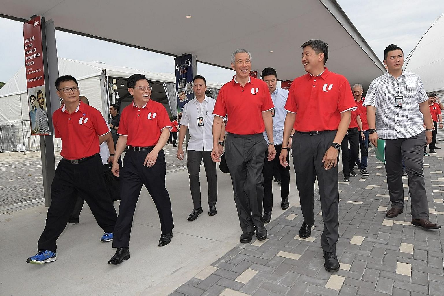 (Front, from left) NTUC vice-president Tan Hock Soon, Deputy Prime Minister Heng Swee Keat, Prime Minister Lee Hsien Loong and labour chief Ng Chee Meng at Downtown East, where Mr Heng addressed 1,600 unionists, workers, employers and Cabinet ministe