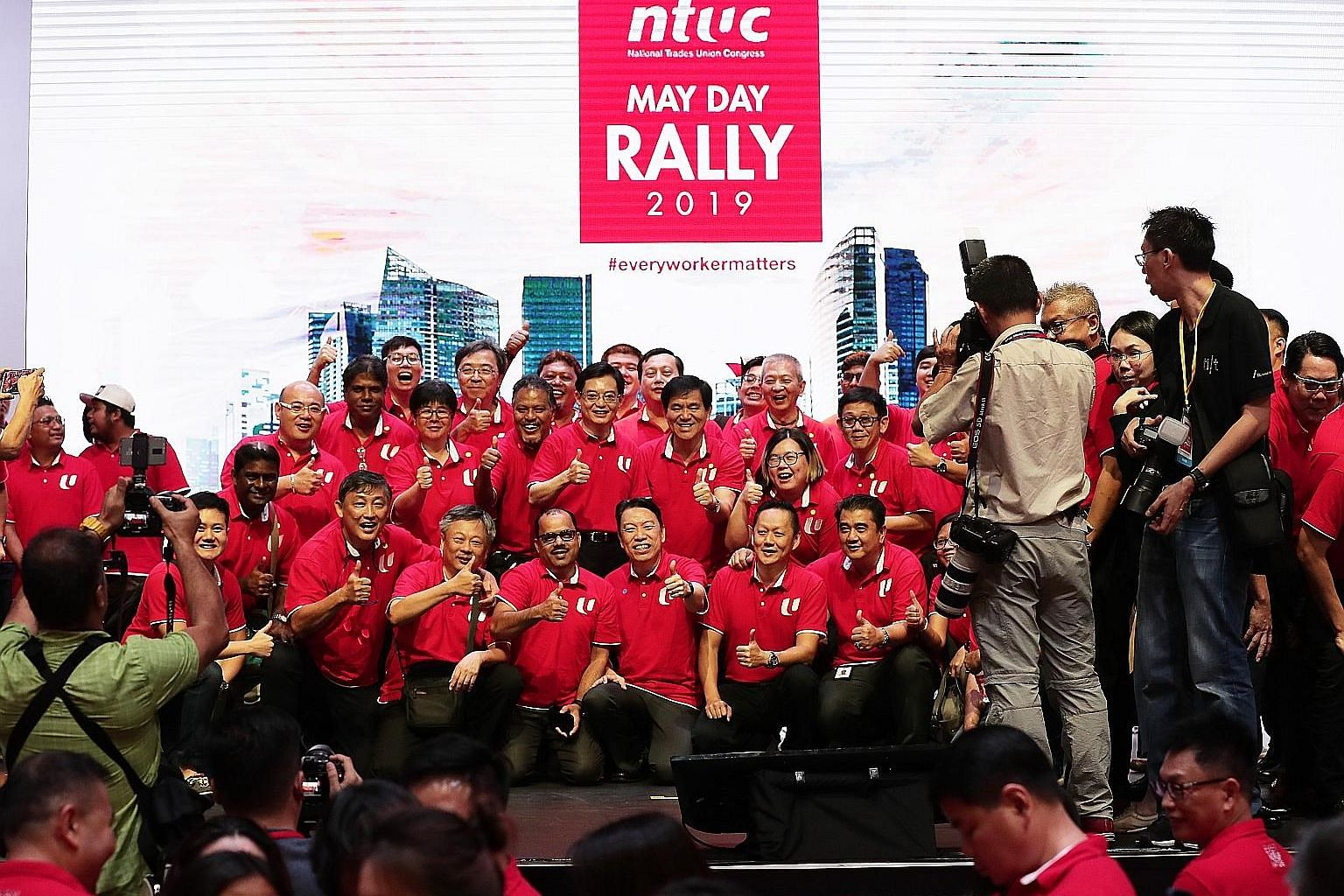 """Deputy Prime Minister Heng Swee Keat in a group photo with members of the labour movement at yesterday's May Day Rally. In his speech, Mr Heng gave the assurance that the """"close symbiotic relationship between the PAP and the NTUC, which underpins our"""
