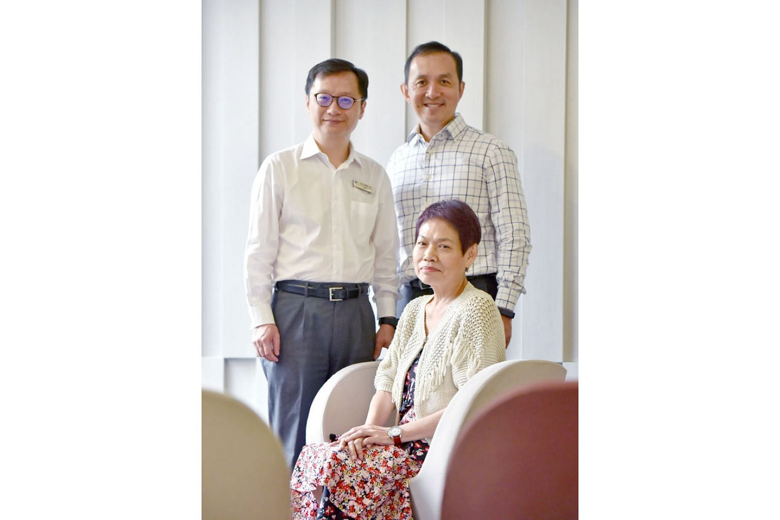 Madam Cindy Chew, one of the trial's participants, with Professor Jimmy So (left), head of the National University Hospital's division of general surgery (upper gastrointestinal surgery), and Dr Yong Wei Peng, senior consultant in the National Univer