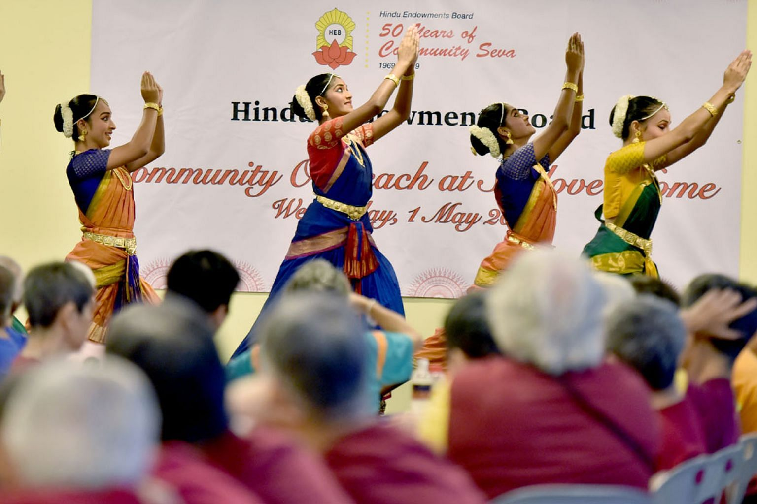 Dancers from Apsaras Arts dance group performing for the residents of Sunlove Home yesterday as part of the Hindu Endowments Board's celebration of its 50th anniversary. The board is marking the milestone by giving back to the community. Some members