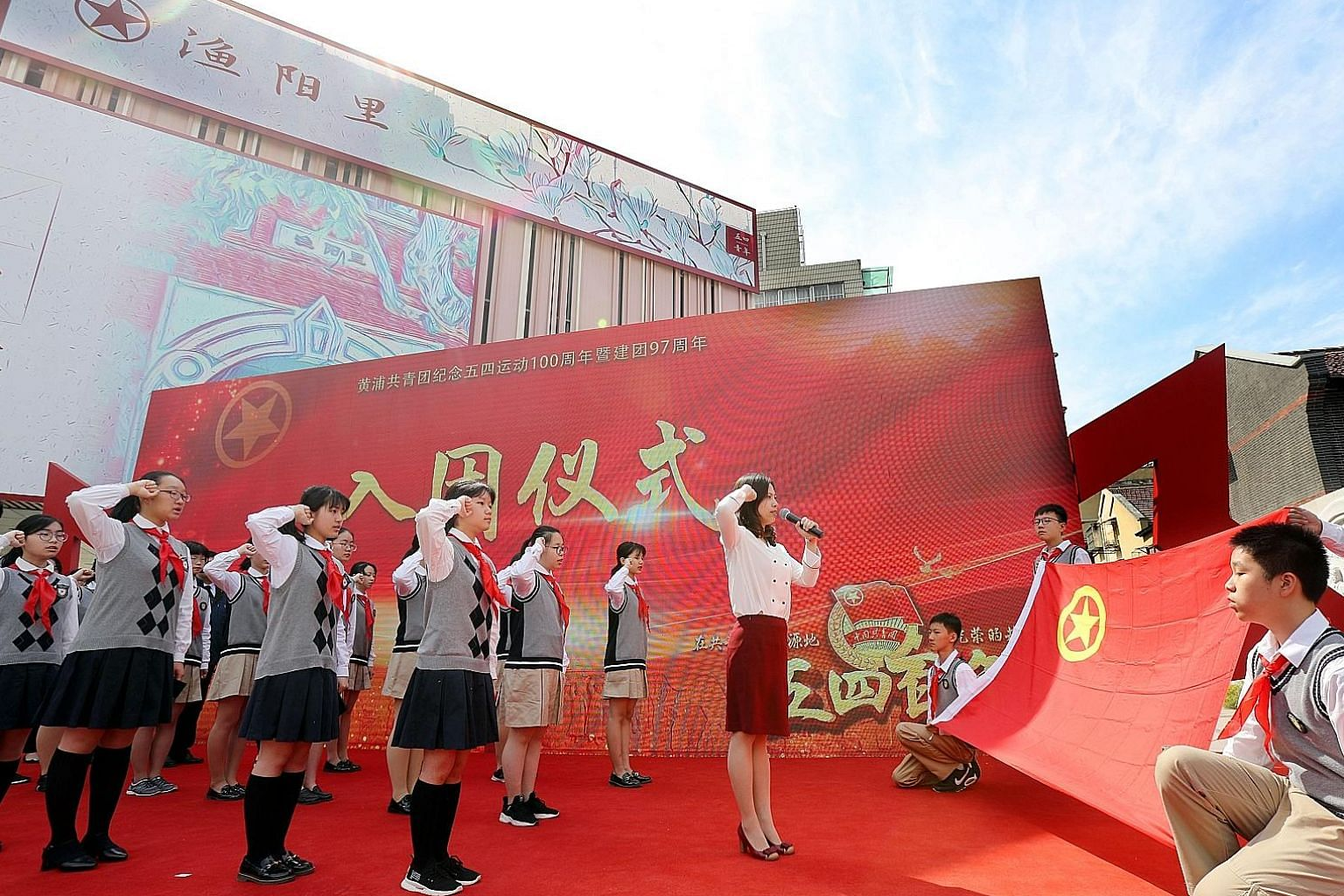 Young people being sworn into the Communist Youth League, the Chinese Communist Party's youth wing, in Shanghai yesterday in conjunction with the centenary of the May 4th movement. President Xi Jinping has again urged the young to embrace the spirit