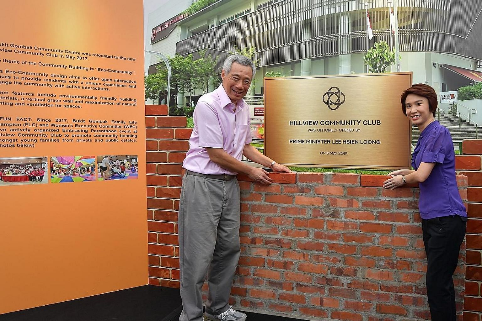 Prime Minister Lee Hsien Loong placing a symbolic brick at the new Hillview Community Club yesterday, in memory of the brick laid by former prime minister Lee Kuan Yew at the same site 56 years ago. PM Lee was with his father on that occasion. Beside