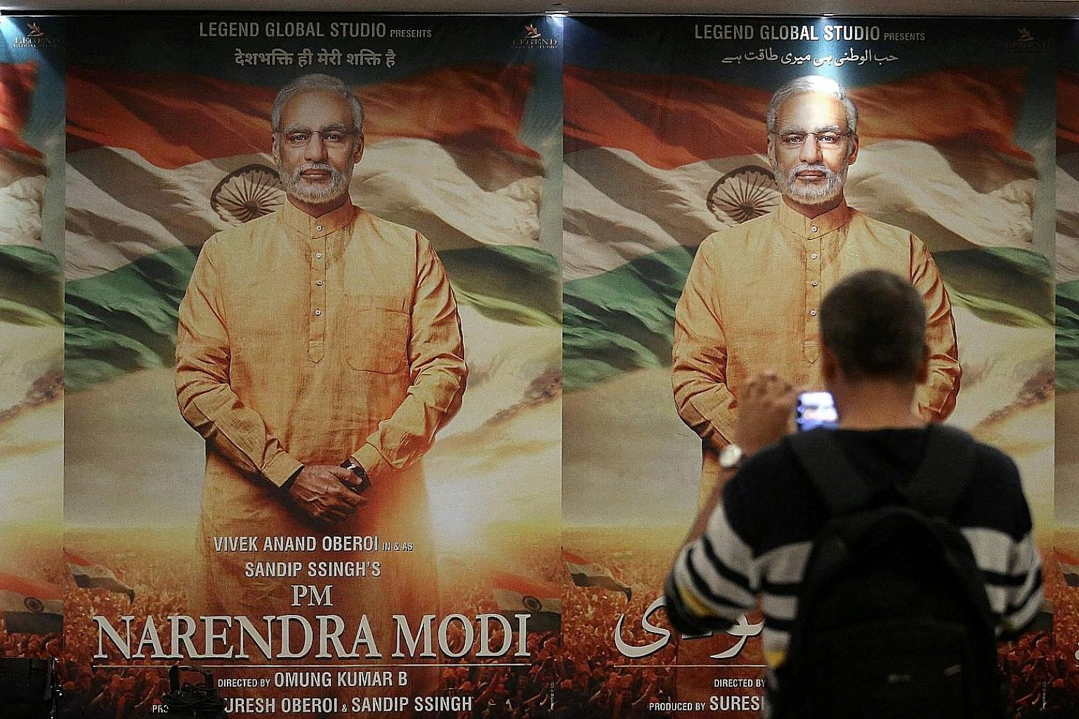 Posters of the film, PM Narendra Modi, in Mumbai. Over 300 million Indians are on WhatsApp and the ruling Bharatiya Janata Party is using it to wage one of the world's most sophisticated digital political campaigns, carried out by a vast army of volu