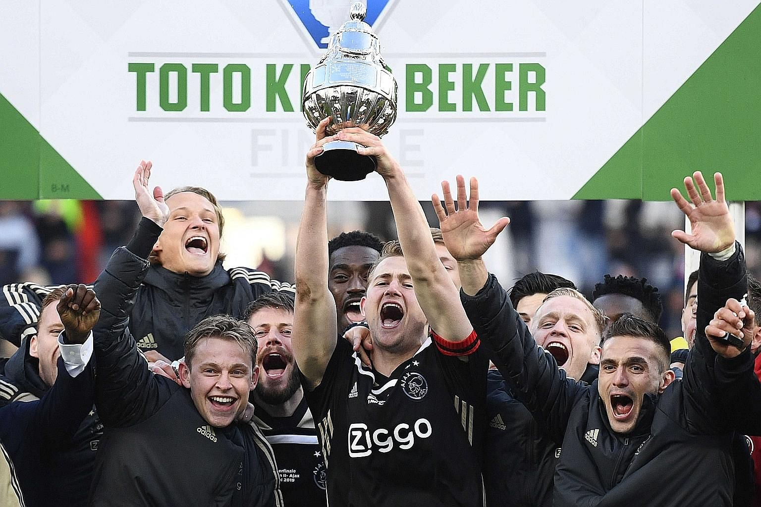 The emergence of promising young players like Frenkie de Jong, Donny van de Beek and Matthijs de Ligt (centre, celebrating Ajax's Dutch Cup victory last Sunday), has been largely down to the work of their coach Erik ten Hag. PHOTO: EPA-EFE