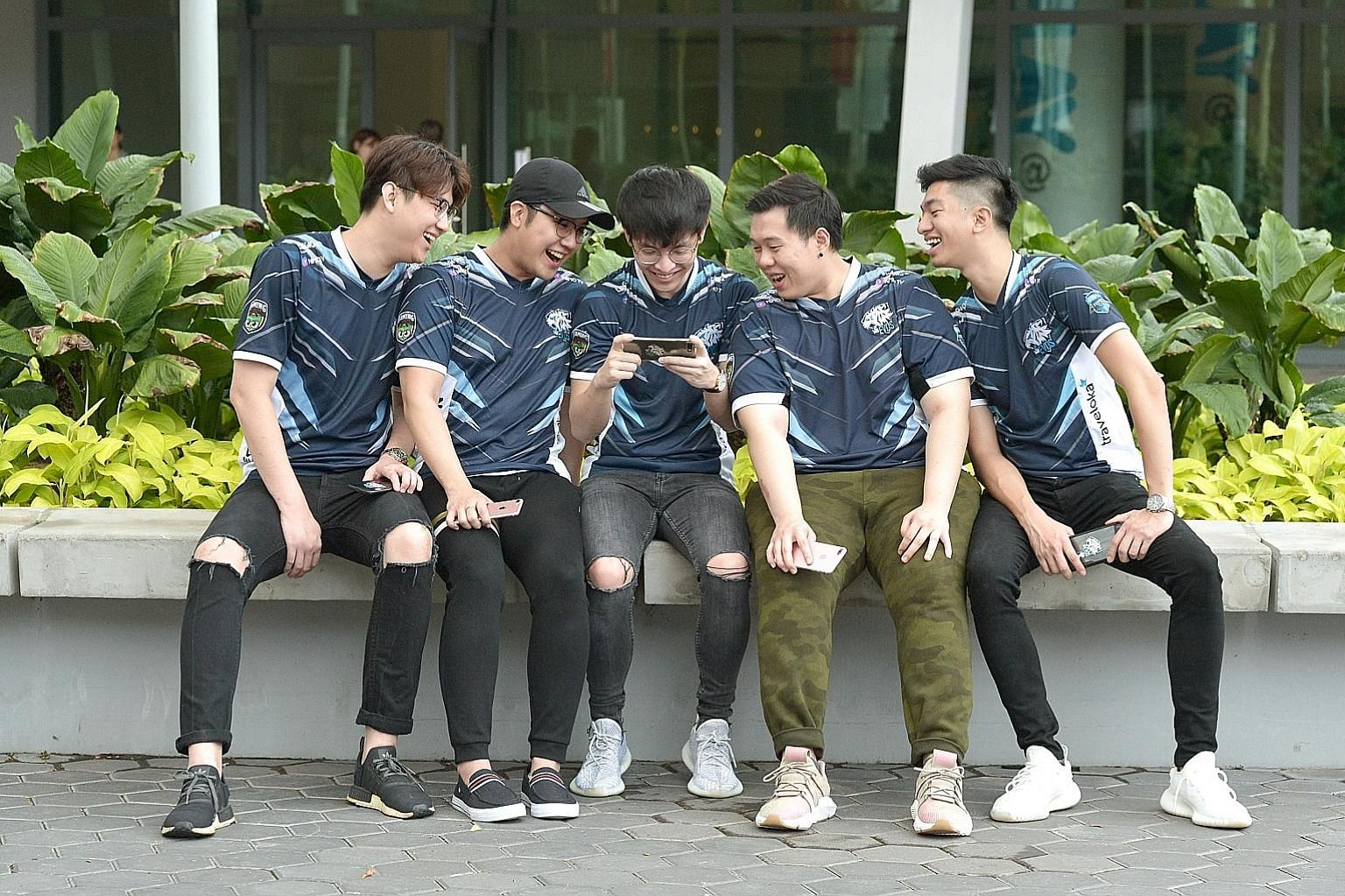 The Evos Esports SG team comprising (from left) Tan Zheng Wei, Akihiro Furusawa, Robert Boon, Andrew Lim and Chong Ru Chyi will be competing in the SEA Clash of Champions tournament in Suntec City. ST PHOTO: SHINTARO TAY