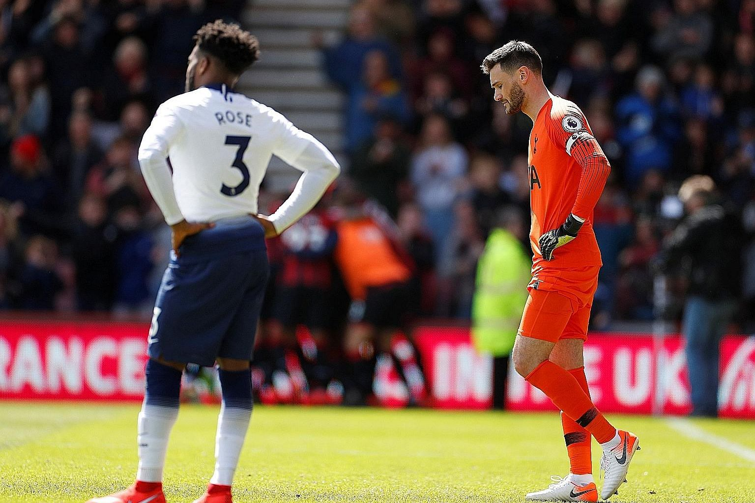 Tottenham goalkeeper Hugo Lloris and defender Danny Rose looking dejected after conceding in added time to lose 1-0 at Bournemouth in the Premier League last Saturday. PHOTO: REUTERS