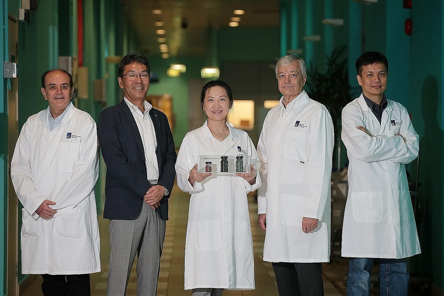 From left: Dr Armando Borgna, principal scientist, Institute of Chemical and Engineering Sciences (ICES); Mr Tomoyuki Kuwata, CEO of IHI Asia Pacific; Dr Chen Luwei, ICES senior scientist; Dr Peter Nagler, ICES executive director; and Dr Poh Chee Kok