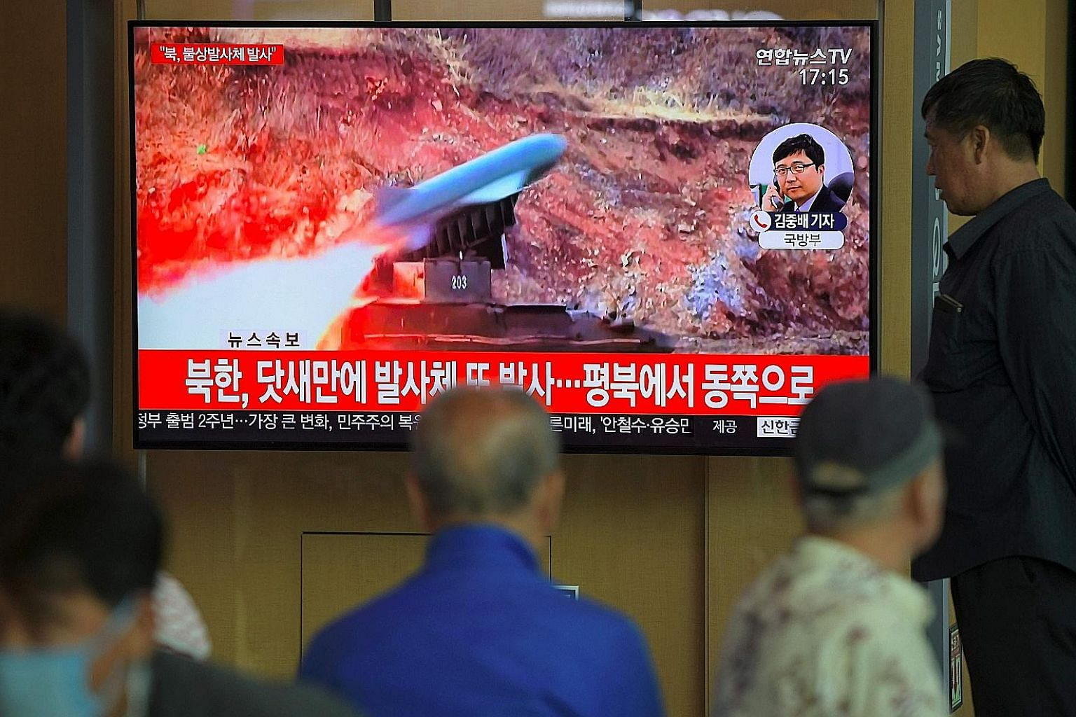 "Passers-by in Seoul watching old footage of North Korea's projectile weapons yesterday. South Korea voiced ""grave concern"" about yesterday's missile launch, saying it would not help efforts to improve inter-Korea ties and ease military tensions on th"