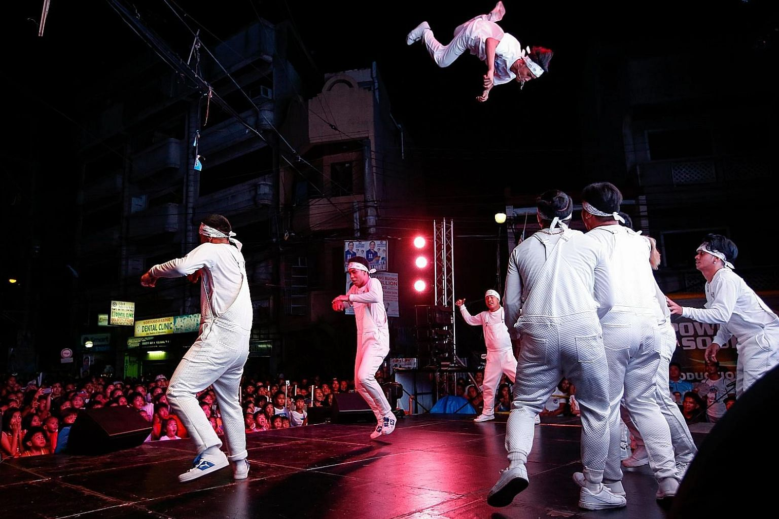 Dancers at a campaign event in Manila for the Philippines' midterm elections. On Monday, more than 60 million Filipinos will head to the polls to elect 12 senators, 297 district representatives and some 18,000 provincial, city and town officials.