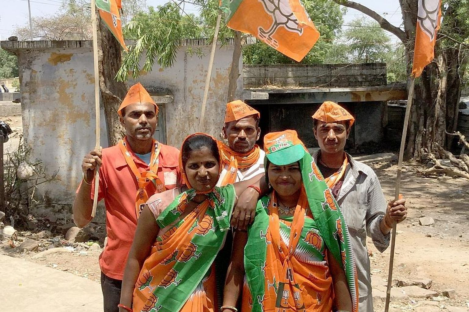 BJP supporters in Bhopal wait to welcome candidate Pragya Singh Thakur, an alleged conspirator in a 2008 terrorism case.