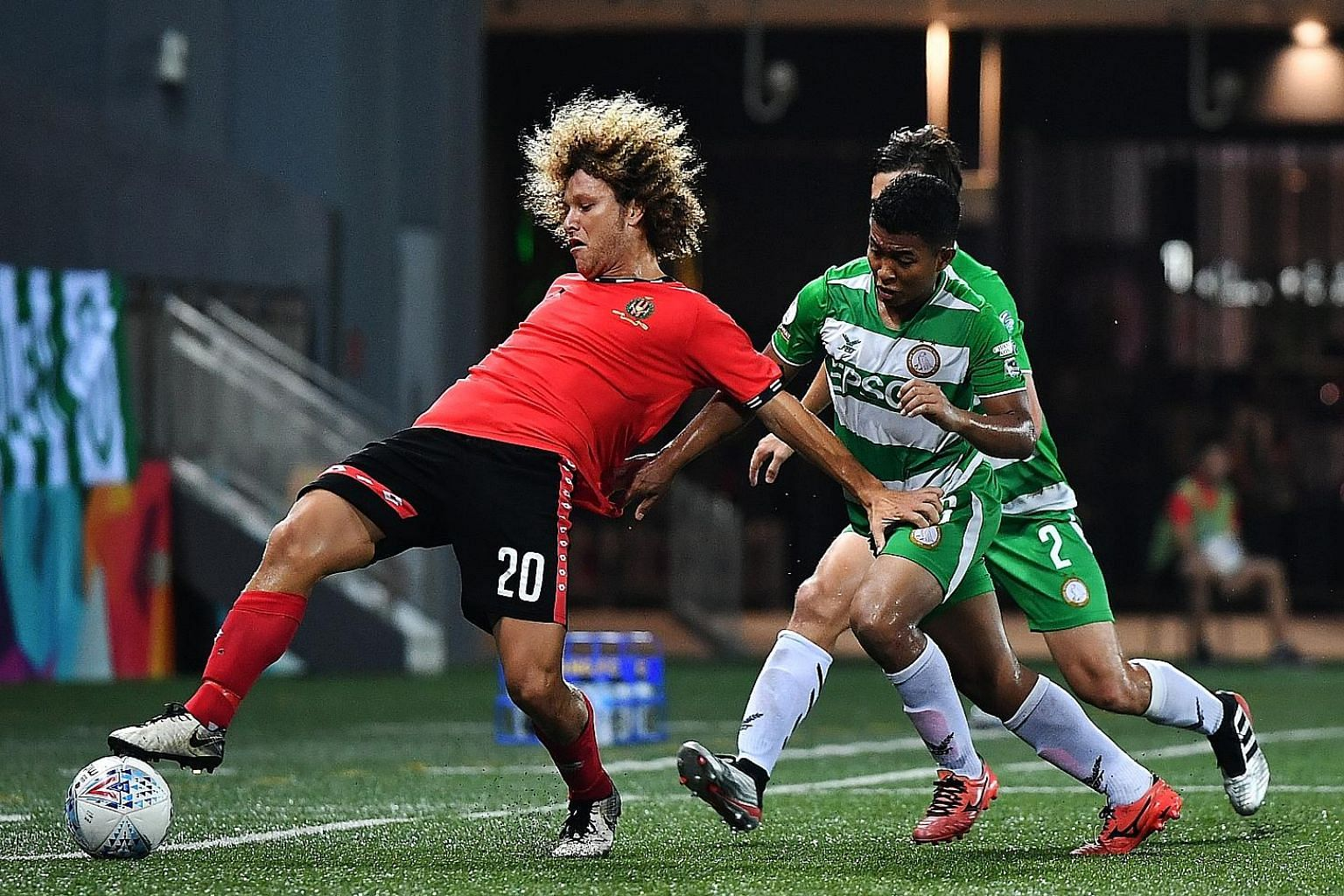 Blake Ricciuto of Brunei DPMM shields the ball from Geylang International's Umar Akhbar. Three first-half goals helped DPMM beat the Eagles 3-1 at Our Tampines Hub, stretching their lead atop the Singapore Premier League (SPL) over second-placed Albi