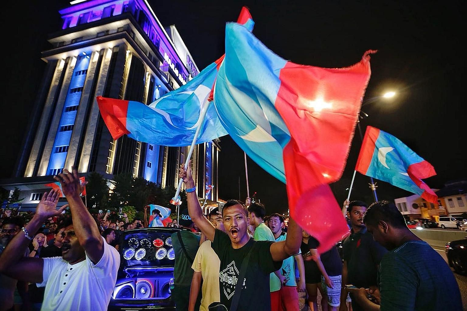 Supporters of Pakatan Harapan (PH) celebrating the coalition's win in Johor Baru last year. A recent Merdeka Centre survey showed that approval ratings for Prime Minister Mahathir Mohamad and PH have plunged since then, with only 24 per cent of Malay